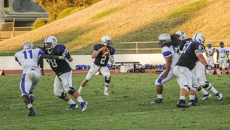 Tanner Trosin, Quarterback for American River College's football team, looks for an open receiver during ARC's first home game.