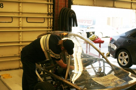 Automotive Tech student Vasily Bessonov works on an EV chassis that is part of the Alternative fuels program. The chassis is one of three that will arrive by the end of September.