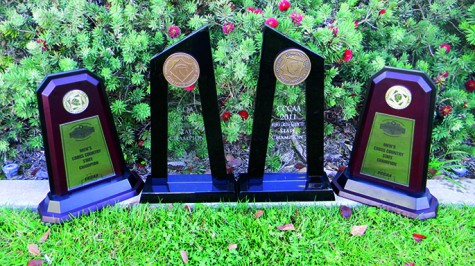 The men's cross country team's first place state championship awards from 2013, 2012, 2011, and 2005.