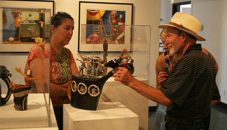 Larry+Williamson+shows+his+viewers+one+of+his+favorite+pieces+called+%E2%80%9CLunch+Dancing+Teapot%E2%80%9D+It+was+created+using+cone+6+ceramic%2C+wood%2C+and+colored+pencil.