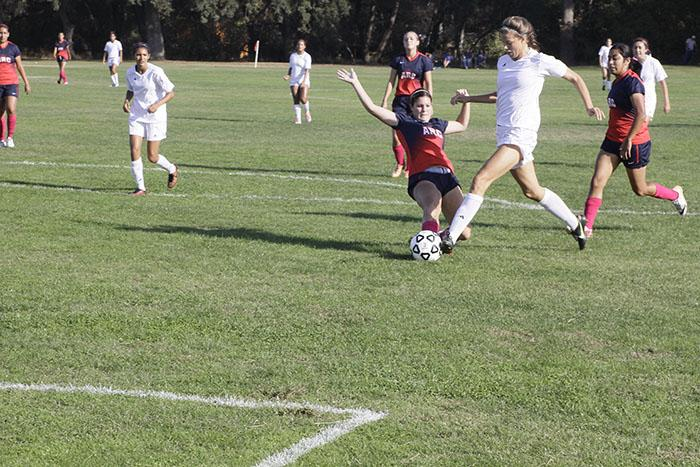 An ARC women's soccer player dives for the ball during their game Oct. 24 against Modesto Junior College.