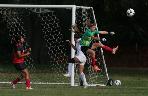 ARC goalie Stephanie Doss leaps to defend her team against Diablo Valley at Friday's game.