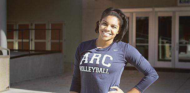 Volleyball player Erianna Williams poses in front of the American River College main gym. (Photo by Ashlynn Johnson)