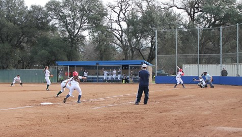 Softball wins first game of season as Albert goes the distance