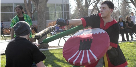 Amtgard club members go to war outside student center
