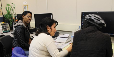 Suzette Brand(left), proctor in the DSP&S department looks on as Irina Li,(middle) Peer couch and also an ARC student volunteer, helping a student with her studies.