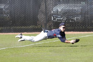 Alex Gaskin makes a diving catch after a line drive by Modesto second baseman Josh Miguel. Gaskin's play ended the third inning.