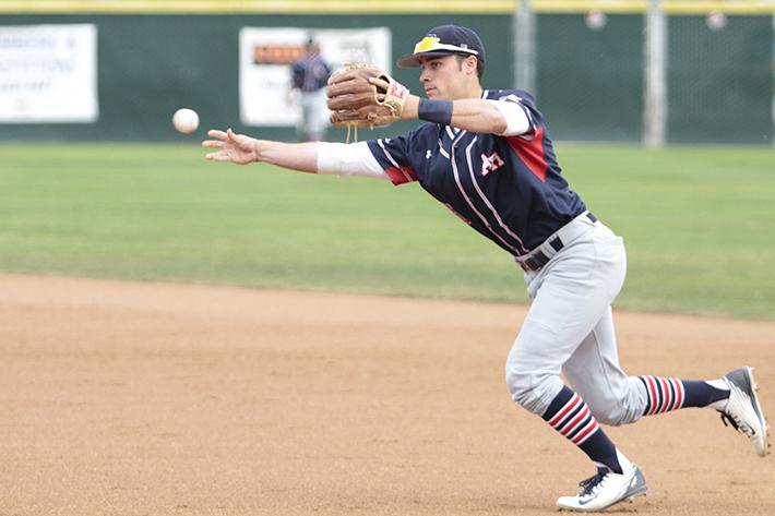 American River College shortstop Cameron Bennett catches the ball before knocking out Sac City's Tyler Houlihan during ARC's win over Sac City.