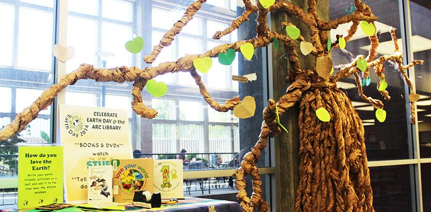 American River College celebrates Earth Day with, among many other things, a paper mache tree located in the Learning Resource Center, for students to write down what they are doing to be friendly  to the earth and taping them to the said tree. Outside the LRC were many activities for students  with food, music and various booths encouraging conscious efforts to help out the environment.