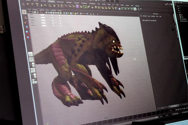 Former animation student Jonathan Camacho, now a professional 3D Animator and modeler, demonstrates for Art New Media students. Here the students watched this geometric shaped animal transform as he pulled out claws and horns on the monster.  He textured the model with available brushes already built it Zbrush and what emerged was a complete 3D monster.