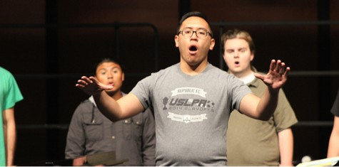 "Tim Mascarinas, a Sacramento State student practicing at ARC, conducts the chamber choir at the rehearsal for their performance ""It Gets Better""."