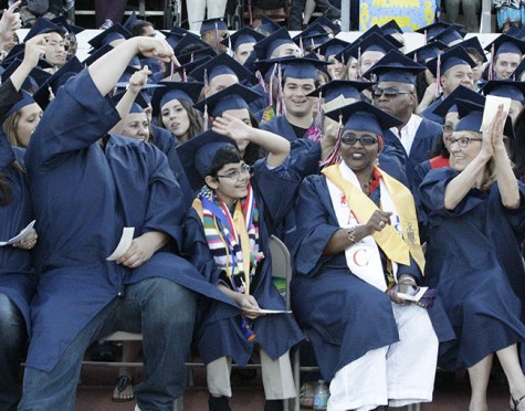 Tanishq Abraham, 11, (center) at American River College's graduation last May. Tanishq's sister Tiara, 9, also studies at ARC.