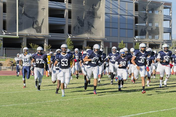 American River College's football team takes the field for its scrimmage on Aug. 28, 2015. Many players and coaches have expressed their excitement for the upcoming season after an 11-2 record in 2014. (Photo by Joe Padilla)