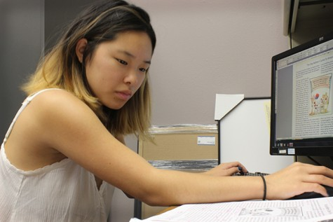 Student worker Emma Jaques designs an upcoming edition of