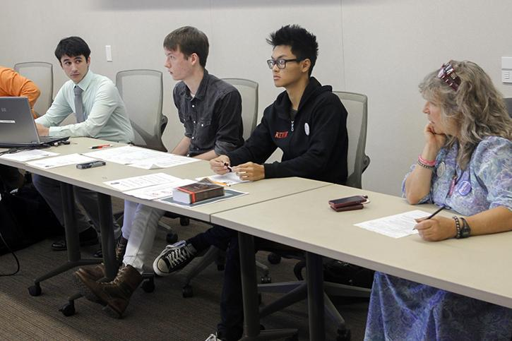 Student Senate President Garrett Kegel, left, Clubs and Events Board President Justin Nicholson, Sen. Kevin Phan and Sen. Laurie Jones discuss student concerns Thursday over the universal transit pass Measure A. Voting will take place Sept. 22-23 on eServices. (Photo by Jordan Schauberger)