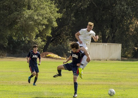 A soccer player from ARC and a player from Feather River College clash as they fight for the possession of the ball in ARC's season opening loss to Feather River College. ARC dominated possession, but couldn't find the back of the net, losing 1-0. (Photo by Joe Padilla)