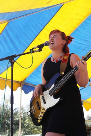Lead singer and bassist, Emma Simpson, sang at Chalk It Up's 25th annual art festival on Labor Day weekend in Fremont park, downtown Sacramento. Simpson was an expressive performer and interacted with her fellow band members and audience members.
