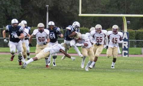 American River College running back Armand Shyne breaks tackles from De Anza defenders on Saturday's win 38-2 win over De Anza College on Saturday, Sept.12 2015. Shyne finished the game with 131 yards rushing. (photo by Joe Padilla)