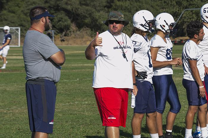 American River College offensive line coach Josh Crabtree gives Head Coach Jon Osterhout a thumbs up during practice on Thursday. The other players are watching the offensive line run through their drills. (photo by Joe Padilla)