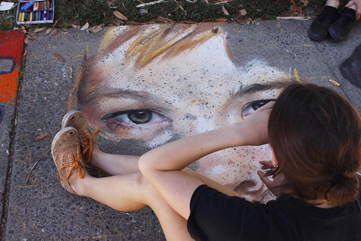 Folsom Lake College student Julia Flippo works on her close up chalk profile of a young girl at Chalk It Up's 25th annual art festival Labor Day Weekend in Fremont park, downtown Sacramento. Flippo placed second in