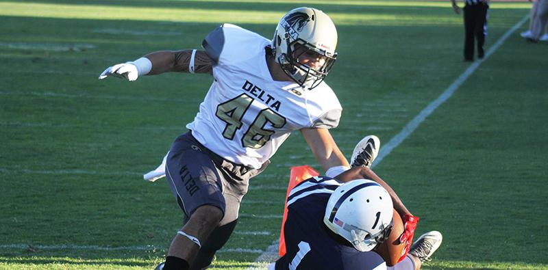 American River College wide receiver Khalil Hudson catches a 29-yard touchdown pass from quarterback Jihad Vercher during ARC football's 44-24 win over San Joaquin Delta College on Saturday, Sept. 19, 2015. Vercher threw for 287 yards and 5 touchdowns. (Photo by Barbara Harvey)