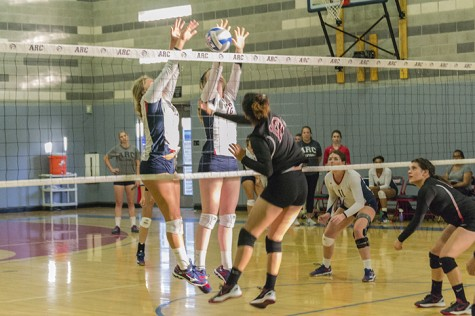 Erin Fogarty and Kaitlin Meyer go above the net for American River College to block a shot from Porterville's Ana Madrigal during the tournament match on Sept. 18, 2015. ARC won the match 25-9, 25-8, 25-13. (Photo by Joe Padilla)