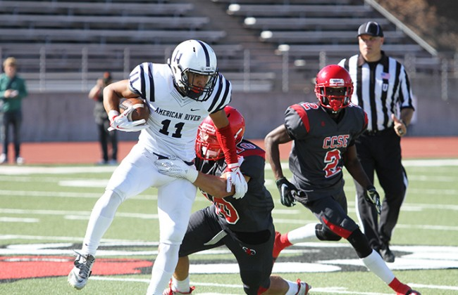 American River College wide receiver Zack Suarez is brought down by City College of San Francisco linebacker Anthony Giusti during ARC's 20-17 win over CCSF on Sept. 26, 2015. ARC's offense had 389 total yards. (Photo by Barbara Harvey)
