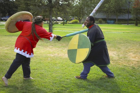 Marcus Birdman, left, a post-grad student and member of the Medieval Fighting Club, spars with Alex Bowie, also a member, during ARC's first club day of the semester on Sept. 24, 2015. (Photo by Kameron Schmid)