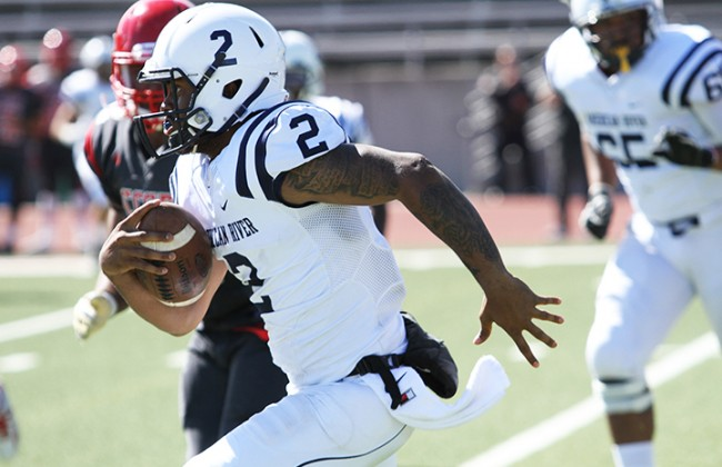 American River College quarterback Jihad Vercher runs the ball during ARC's 20-17 win over City College of San Francisco on Sept. 26, 2015. Vercher threw for 280 yards and one touchdown and had 31 rushing yards. (Photo by Barbara Harvey)