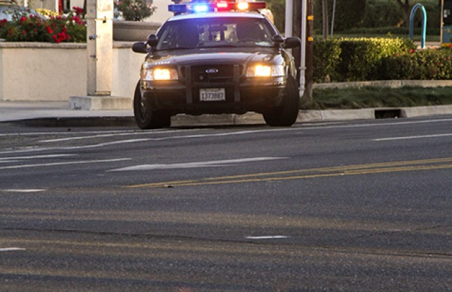 A police car blocking off Sutterville Road from drivers after the shooting at Sacramento City College on Thursday that left one dead and two injured.