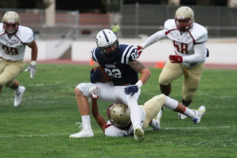 American River College wide receiver Jacob Sipes is brought down by De Anza defensive back Christian Rita during ARC's 38-2 win over De Anza at the home opener on Sept. 12, 2015. ARC amassed 31 points in the first half alone. (Photo by Barbara Harvey)