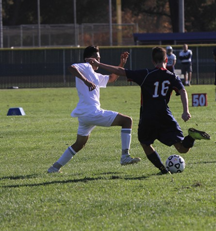 American River College freshman defenseman Ryan Kane,left, tries to kick the ball past Napa Valley College's Edgar Ayala during ARC's 1-0 loss against Napa on Thursday Sept.17, 2015. Both teams struggled on to score during the game , as the game's only goal came in the first half. (photo by Matthew Wilke)
