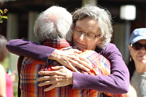 Robert Meyer, the husband of Sacramento City College biology professor Virginia Meyer, and Mary Ann Robinson, an employee at the college's library, hug at the