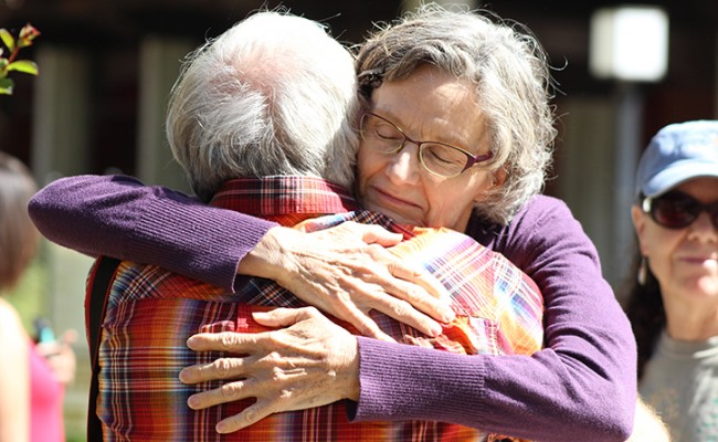 "Robert Meyer, the husband of Sacramento City College biology professor Virginia Meyer, and Mary Ann Robinson, an employee at the college's library, hug at the ""love-in"" held at the Quad at Sacramento City College on Sept. 4, 2015, the day after a fatal shooting occurred on campus. (Photo by Barbara Harvey)"