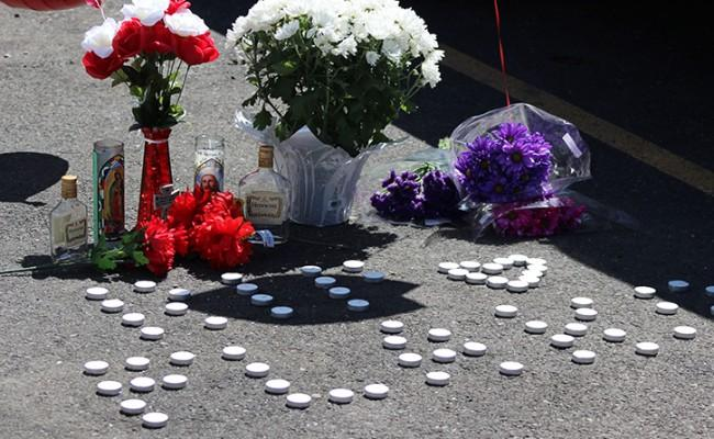 A memorial at the spot where Sacramento City College shooting victim Roman Gonzalez was killed was erected by family and friends on Sept. 4, 2015. Friends and family members were present during the love-in, but declined to comment. (Photo by Barbara Harvey)