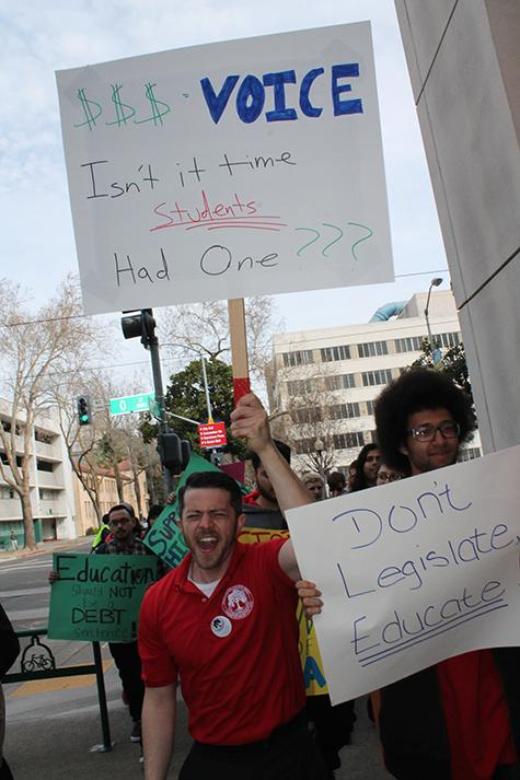 Cameron Weaver protests at the annual March In March in downtown Sacramento last spring. Weaver was elected as Student Trustee last spring, a paid position on the Los Rios Community College District's Board of Trustees. (File photo)