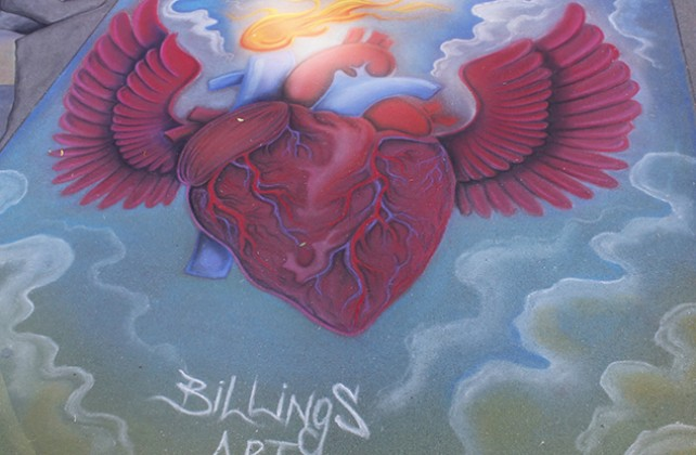 "What appears to be a realistic representation of a heart with wings at Chalk It Up's 25th annual art festival on Labor Day weekend in Fremont park, downtown Sacramento. At the bottom of the piece is reads ""Billings Art"" a watermark left by the artist. (Photo by Cheyenne Drury)"