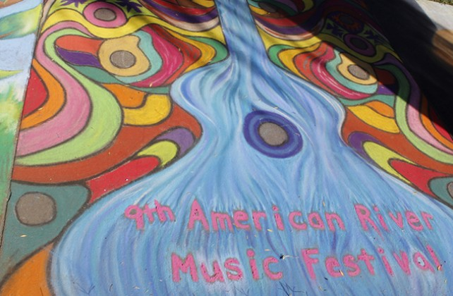 An advertisement for the 9th American River Music Festival at Chalk It Up's 25th annual art festival on Labor Day weekend in Fremont park, downtown Sacramento. Street chalk was sold at the event but previously purchased chalk was welcomed to use. (Photo by Cheyenne Drury)