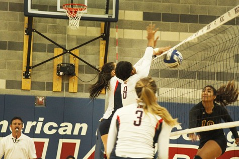 Sophomore middle blocker Erianna Williams, middle, and freshman outside hitter Candice Reynoso, left of Williams, block a spike attempt by Hartnell sophomore Neysha Laumatia. ARC won 3-2 and also won their second match of the doubleheader against Hartnell College on Aug 28, 2015. (photo by Kameron Schmid)