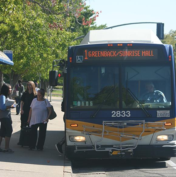 Students board the No. 1 Bus on the corner of College Oak Drive and Orange Grove Avenue adjacent to American River College. Students should support Measure A, which would renew the universal transit pass for Los Rios students. (Photo by John Ferrannini)