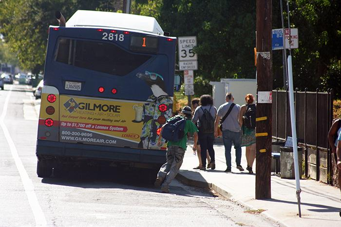 Students walk toward the entrance of the No. 1 Bus on the corner of College Oak Drive and Orange Grove Avenue on Aug. 31, 2015. Measure A, which renewed the universal transit pass, has passed after a vote by Los Rios students on eServices. (Photo by John Ferrannini)