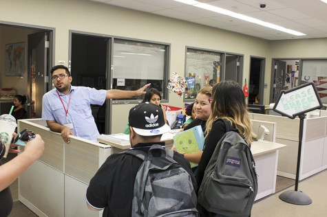 Felipe Gomez, a student personnel assistant in the Journey program, gives students information before they check into the program. The Journey program was given a third of a $3.3 million grant ARC received from the U.S. Department of Education. (Photo by Jordan Schauberger)