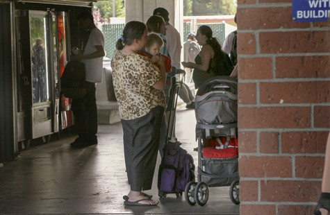 A woman holding a toddler outside of Davies Hall on American River College Campus. There is a daycare facility available in the child development center to assist parents who attend ARC and have no other way for their children to be watched. (Photo by Mychael Jones)
