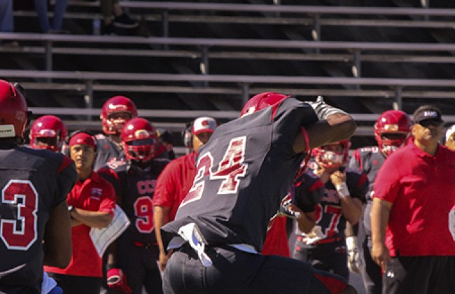 City College of San Francisco defensive back Deante Fortenberry jumps over American River College Defensive lineman Anthony Luke during a play at the game against CCSF on Sat. Sept. 26 where ARC won against CCSF 20-17. (Photo by Ashlynn Johnson)