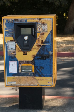A parking ticket machine in lot A near the automotive department on campus. This one of several malfunctioning machines on campus. (Photo by Nicholas Corey)