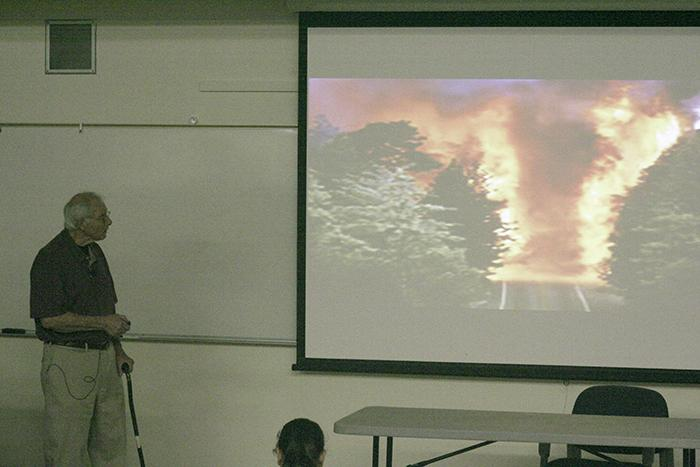 Fire Science Professor Al Iannone shows a slide showing wildfires during a school College Hour that mainly covered prepaining for wildland fires on Sept. 3, 2015. (Photo by Matthew Nobert)
