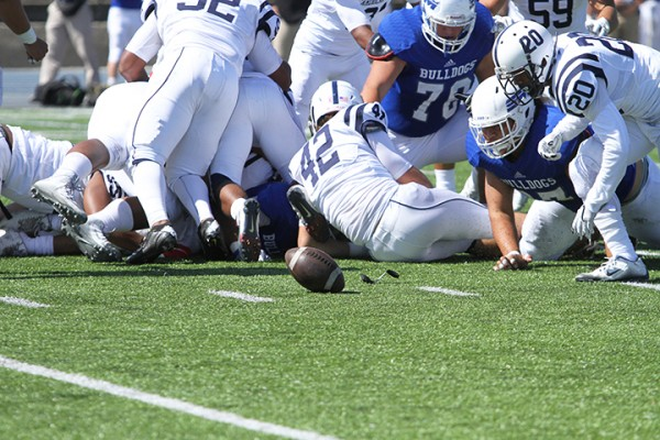 American River College defensive back Robert Sanders scrambles to recover a College of San Mateo fumble during ARC football's 42-10 loss to CSM on Saturday, Oct. 3, 2015. Sanders returned the fumble for a touchdown, giving ARC its only touchdown of the game. (Photo by Barbara Harvey)