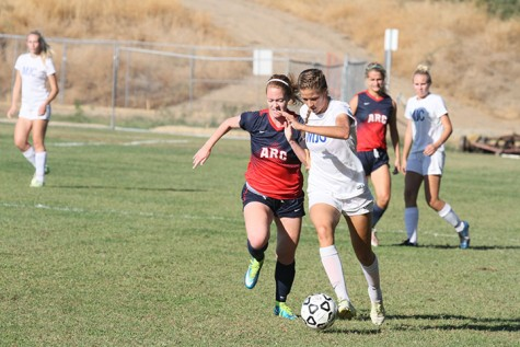 Modesto Junior College forward Jenna Viss (22) steals the ball from ARC defensive player Kristen Grattan (5) during ARC's 2-0 win over MJC on Oct 2, 2015. ARC's record advanced to 5-3 with the win. (photo by Matthew Wilke)