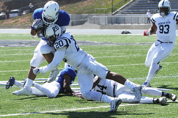 American River College defensive back Robert Sanders tackles  a College of San Mateo running back in mid-air during ARC football's 42-10 loss to College of San Mateo on Saturday, Oct. 3, 2015. Sanders had ARC's only touchdown on a returned fumble during the first quarter. (Photo by Barbara Harvey)