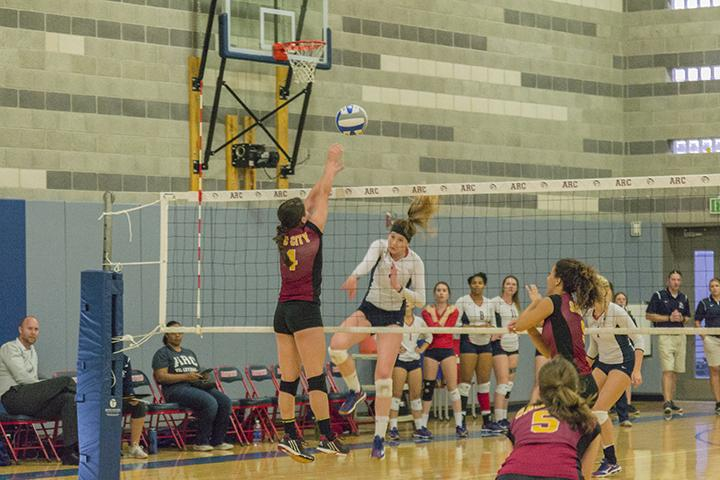 American RIver College libero and defensive specialist Nora Troppmann scores over Samantha Kepler of Sacramento City College during her team's match at home on Oct. 2, 2015. ARC went on to win the match 3 games to none. (photo by Joe Padilla)